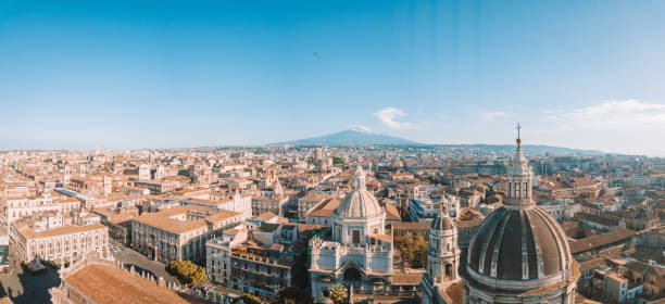 Beautiful aerial view of the Catania city near the main Cathedral Beautiful aerial view of the Catania city near the main Cathedral and Etna volcano on the background. Amazing old town view from above. catania stock pictures, royalty-free photos & images