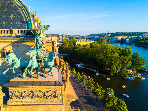 Beautiful aerial view of the Prague National Theatre Beautiful aerial view of the Prague National Theatre along the river Vltava. Amazing theatre view during sunset with horse sculptures on the roof. czech culture stock pictures, royalty-free photos & images