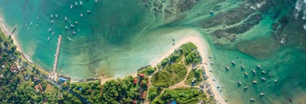 beautiful aerial view of tropical coastline and fishman village - fishman imagens e fotografias de stock