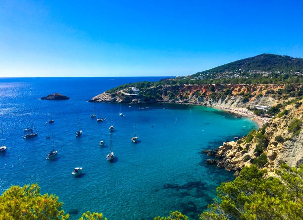 Beautiful aerial view on cala d'hort beach. Ibiza, Balearic Islands, Spain. Beautiful aerial view on cala d'hort beach, boats, yachts, blue sky and sea. Ibiza, Balearic Islands, Spain. ibiza island stock pictures, royalty-free photos & images