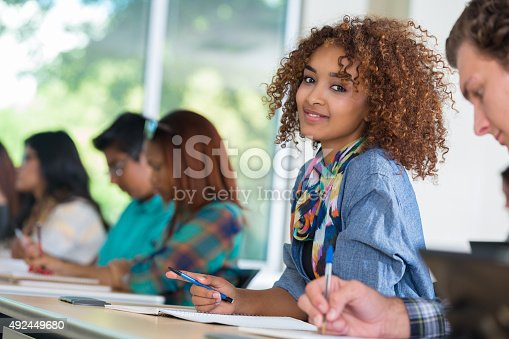 istock Beautiful African American college student in modern classroom 492449680