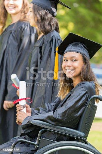 istock Beautiful African American female college graduate 613884556
