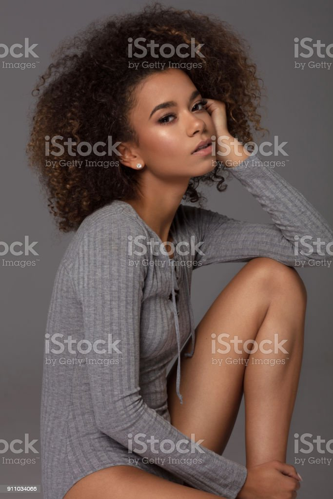 Beautiful african american female model. Natural photo without retouch