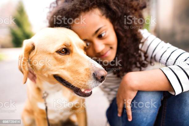 Beautiful african american girl walking with her dog picture id698725414?b=1&k=6&m=698725414&s=612x612&h=thgdzjfoa5 2hsjsjrnfvvkpdnn tpqdzq5n kkeysc=