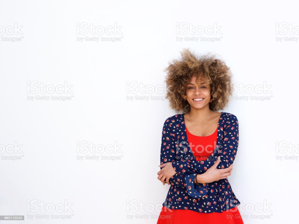 beautiful african american girl with curly hair standing against white backgorund stock photo