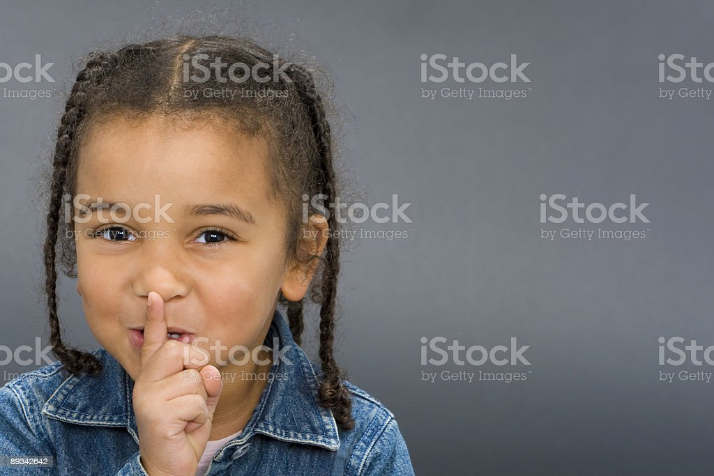 Beautiful African American Interracial Girl Finger to Her Lips stock photo
