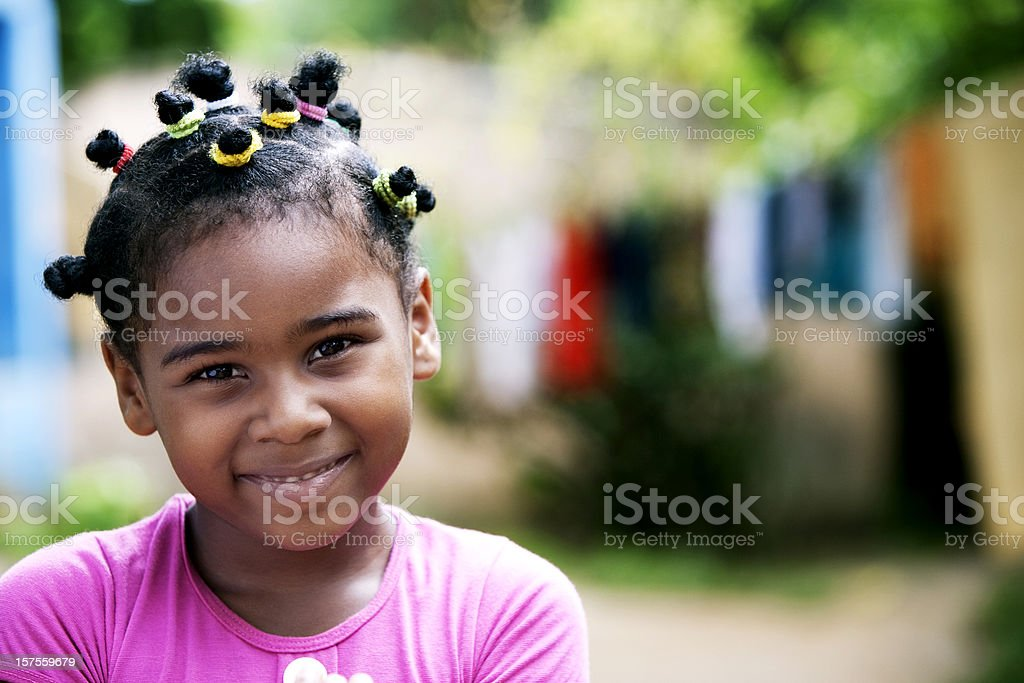 Beautiful African American Little Girl Smiling and Looking at Camera stock photo