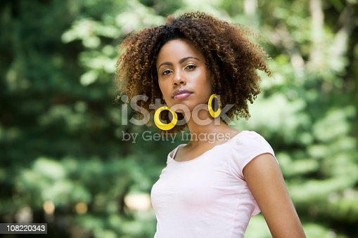 Beautiful African American model outside. Copy space.