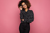 Beautiful black woman model wear black shirt in peas and holding glasses