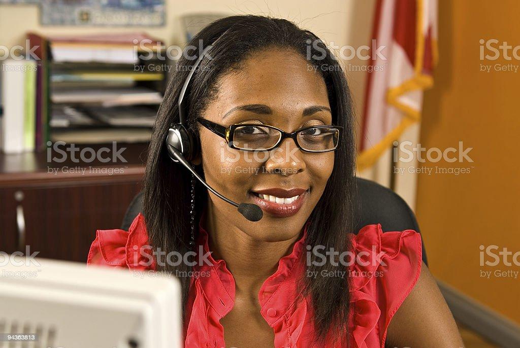 Beautiful African American Receptionist stock photo