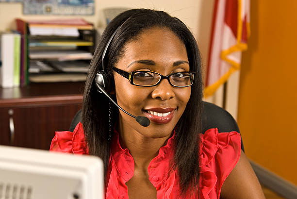 Beautiful African American Receptionist stock photo
