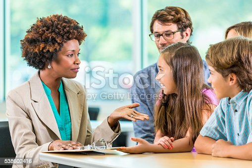 istock Beautiful African American teacher meets with Family 538602416