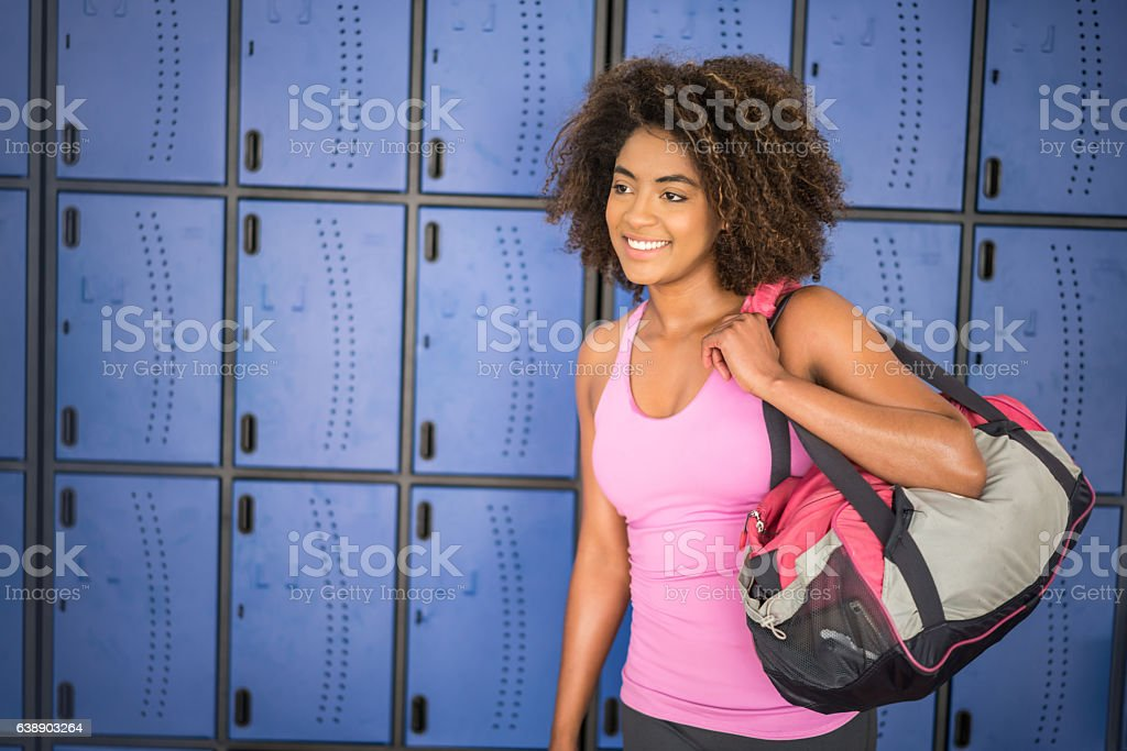 Beautiful African American woman at the gym stock photo