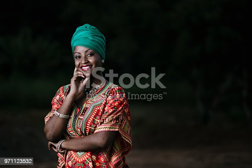 istock Beautiful african american woman in typical afro clothing 971123532
