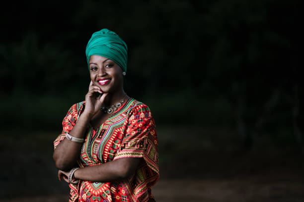 beautiful african american woman in typical afro clothing - african culture stock photos and pictures