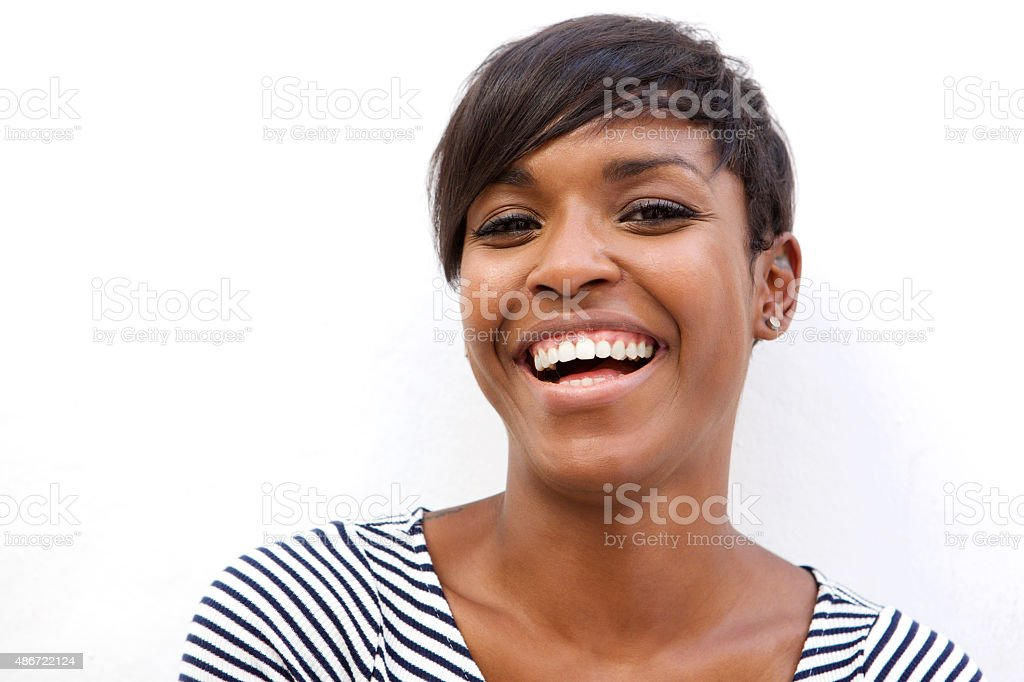 Beautiful african american woman laughing stock photo