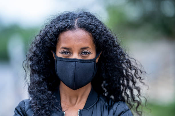 Beautiful African American Woman Wearing a Protective Face Mask stock photo