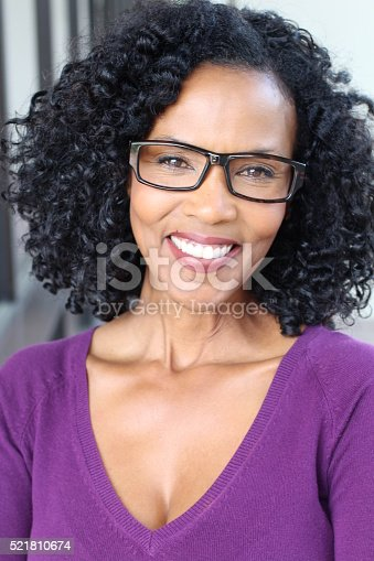 istock Beautiful African American woman wearing glasses 521810674
