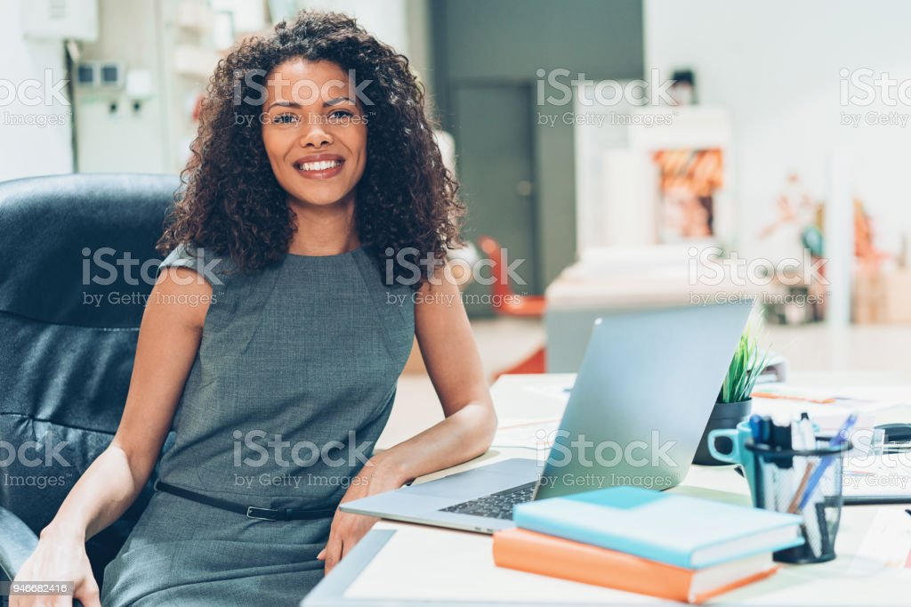 Smiling young businesswoman in the office
