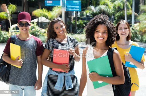 istock Beautiful african female student with group of international students 698137590