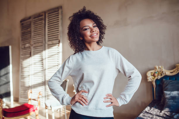 beautiful african girl dressed in blank sweatshirt standing in the - sweatshirt stock photos and pictures