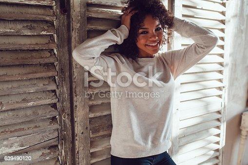 613542420 istock photo Beautiful African girl dressed in blank sweatshirt standing on wood 639490120