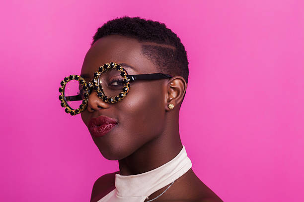 beautiful african girl portrait wearing odd glasses and smiling - エキセントリック ストックフォトと画像