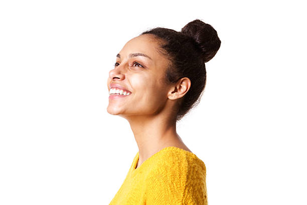 Beautiful african lady looking away and smiling Close up portrait of beautiful african lady looking away and smiling on white background side view stock pictures, royalty-free photos & images