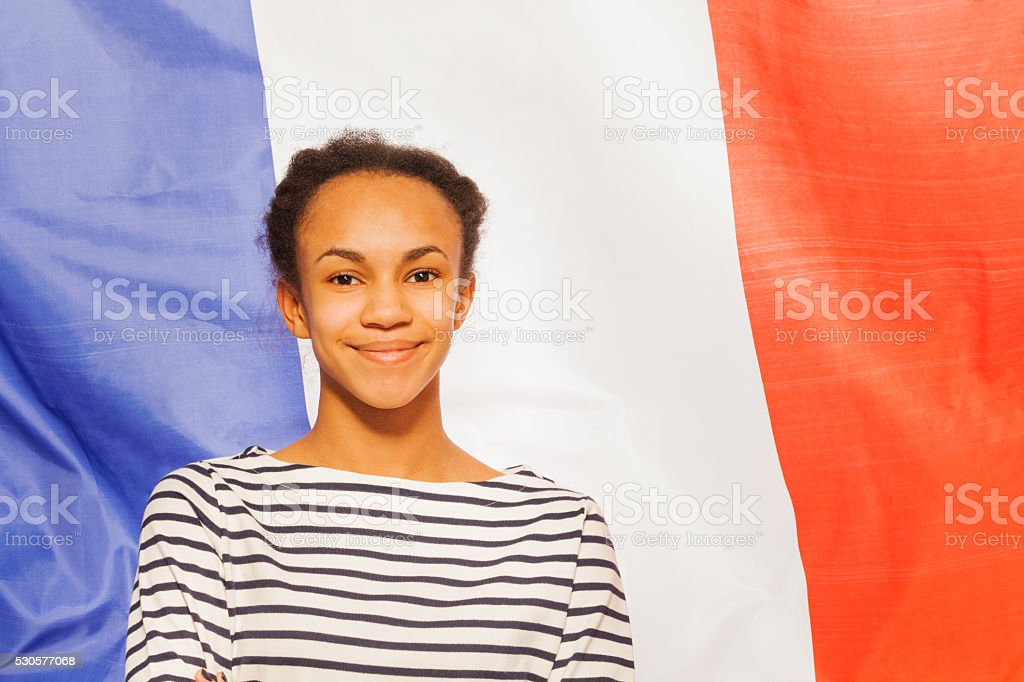 Beautiful African teenage girl with French flag stock photo