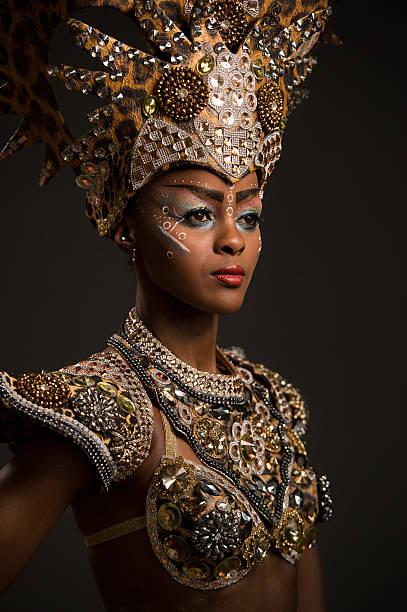 beautiful african woman wearing carnival dress - afrikanische masken stock-fotos und bilder