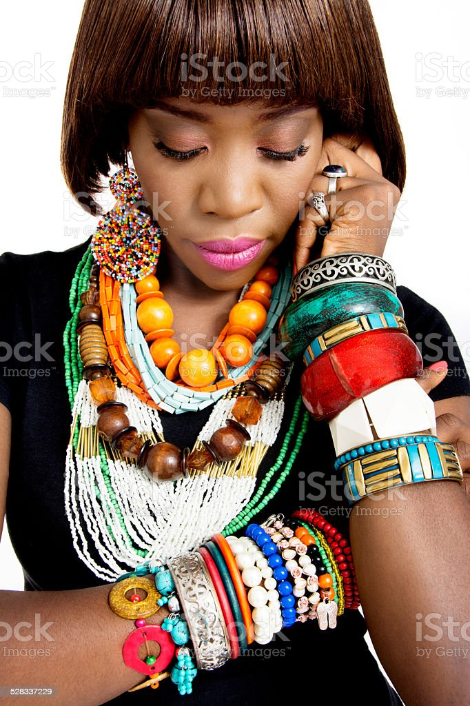 Beautiful African Woman Wearing Excessive Accessories stock photo