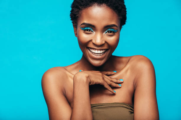 beautiful african woman with vivid makeup - make up stock photos and pictures