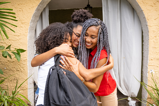Beautiful African-American Teenager Arriving Home with Backpack in Miami Florida