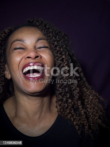 Vertical portrait of an Afro American woman laughing