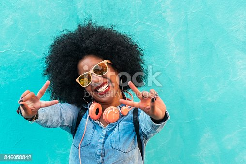 istock Beautiful afro american woman making peace sign. 846058842