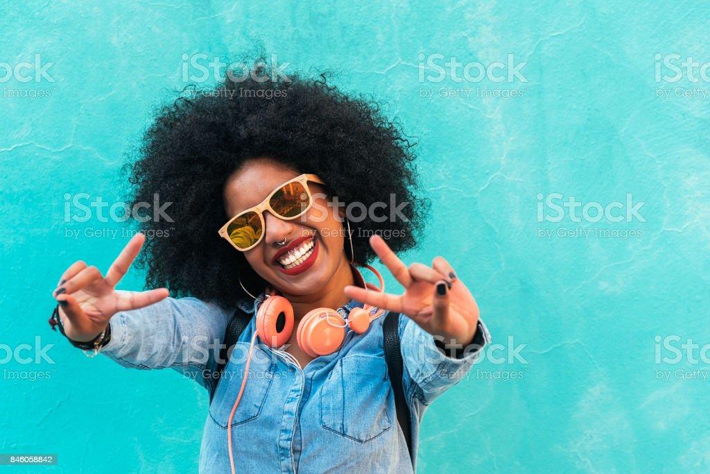Beautiful afro american woman making peace sign. stock photo