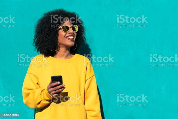 Beautiful afro american woman using mobile in the street picture id909457386?b=1&k=6&m=909457386&s=612x612&h=dutdayefyqlc toquuh6hekowq07q3udzhnt9 rtej0=