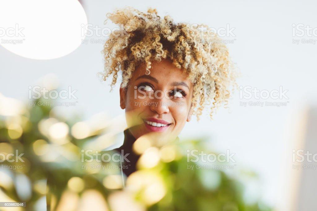 Beautiful afro american young woman Beautiful afro american young woman looking up. Indoor portrait. Adult Stock Photo