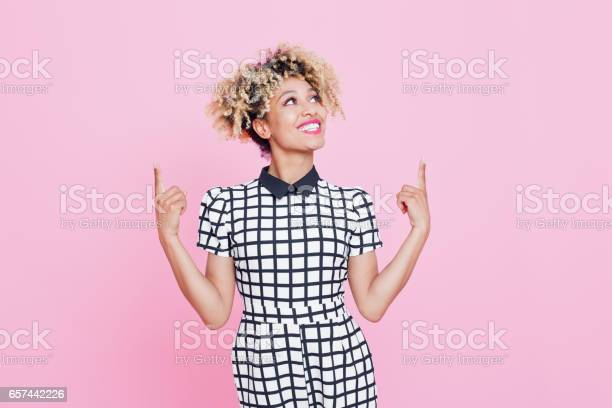 Beautiful Afro American Young Woman Pointing At Copy Space Stock Photo - Download Image Now