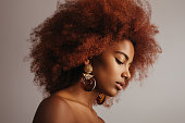 istock Beautiful afro girl with earrings 1243856581