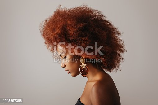 Beautiful afro girl with earrings