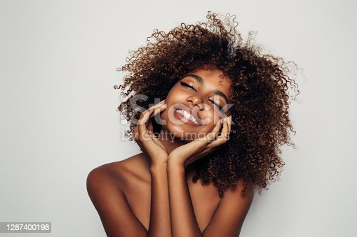 istock Beautiful afro woman with perfect make-up 1287400198