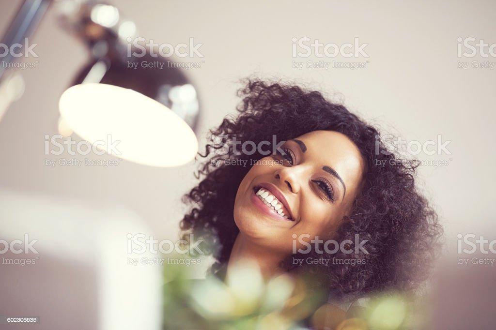 Beautiful afro young woman smiling Beautiful afro young woman smiling, close up of face, indoor shot.  Adult Stock Photo
