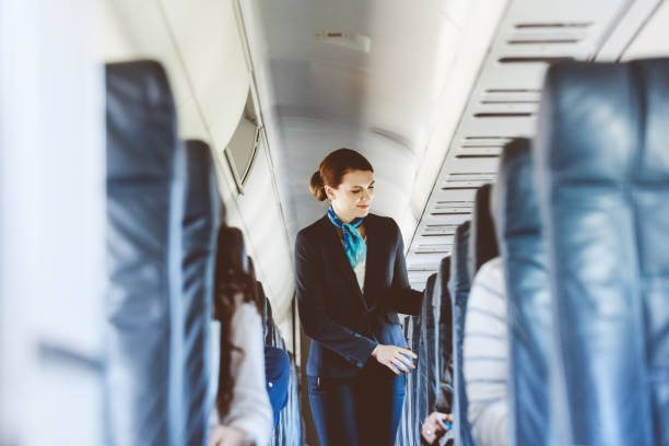Beautiful air stewardess inside an airplane Beautiful air stewardess inside an airplane. passenger stock pictures, royalty-free photos & images