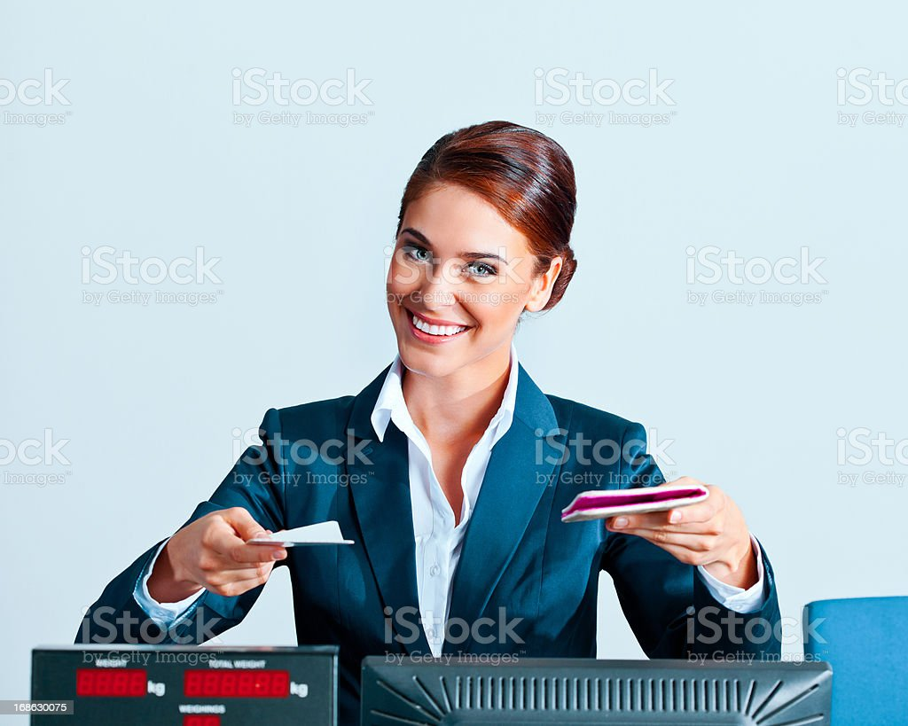 Beautiful airline check in attendant stock photo