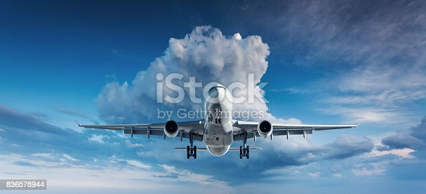 816320512 istock photo Beautiful airplane. Landscape with white passenger airplane is flying in the blue sky with clouds at overcast day. Travel background. Passenger airliner. Business trip. Commercial plane. Aircraft 836578944