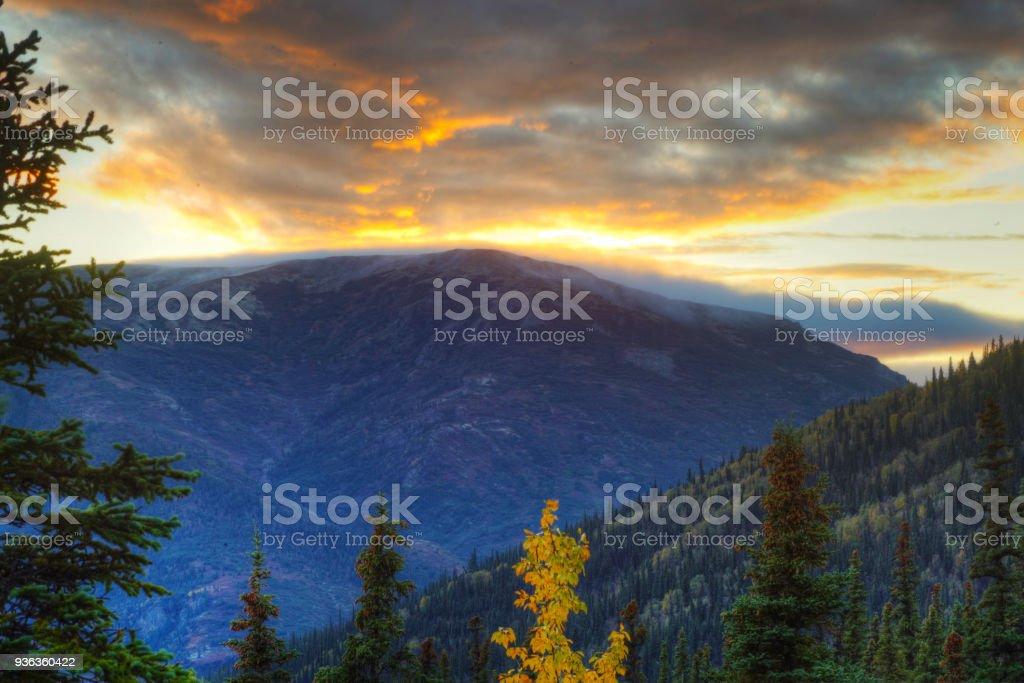 A beautiful Alaskan sunset among mountains and valleys. stock photo