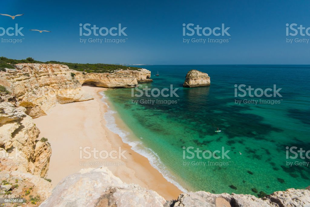 Beautiful Algarve coast with cristal clear water, Portugal. stock photo