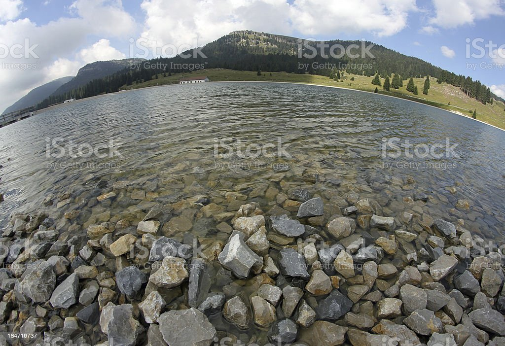 beautiful alpine lake surrounded by high mountains royalty-free stock photo