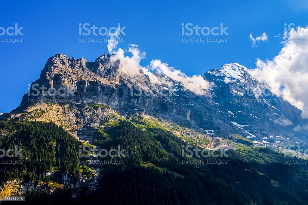 Beautiful Alpine landscape over blue sky, Switzerland. stock photo